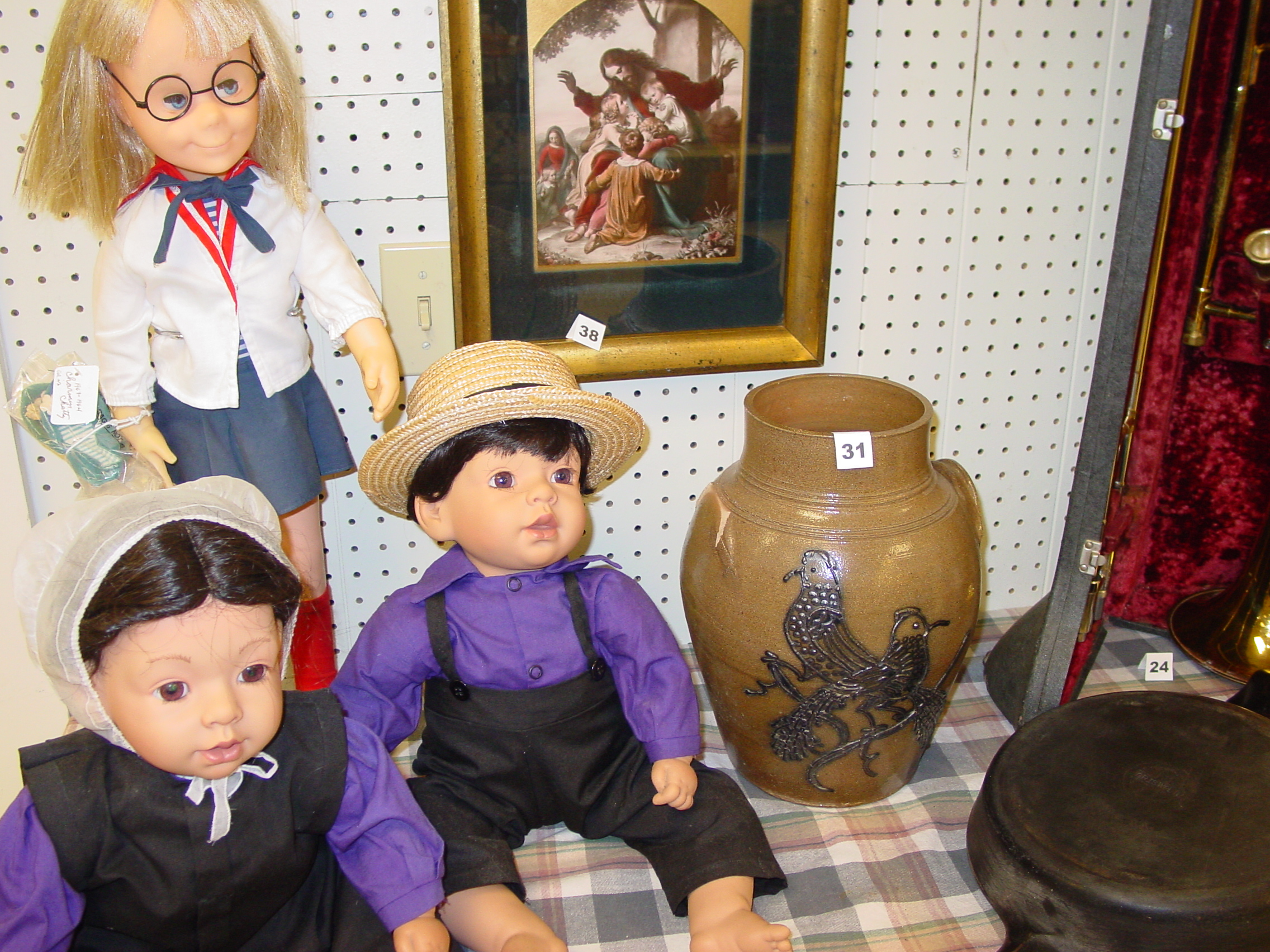 Amish dolls are in the silent auction.  All purchased items must be picked up in the store.