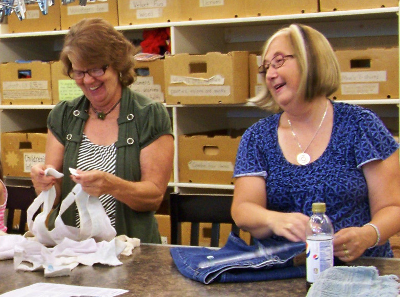 Volunteers sorting incoming clothing