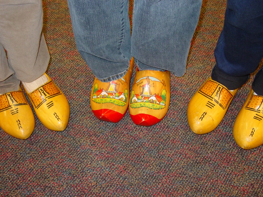 Store volunteers try on wooden shoes.